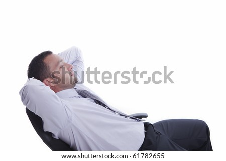 Young businessman relaxing in his business leather chair, isolated on white