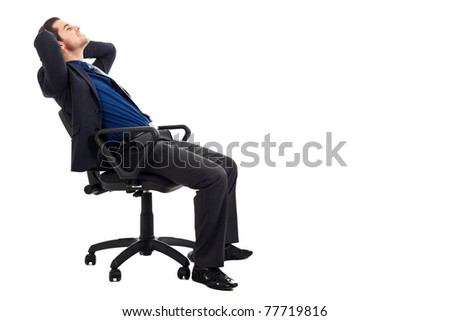 Young businessman relaxing on a chair isolated on white - stock photo