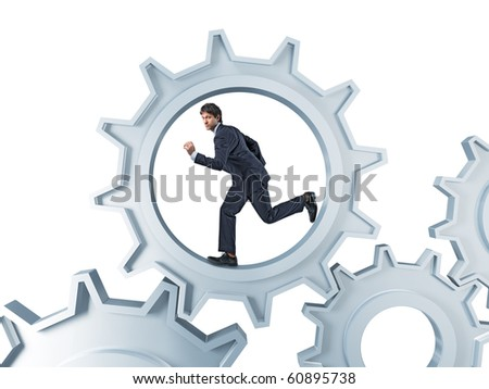 young businessman run inside of metal gera engine