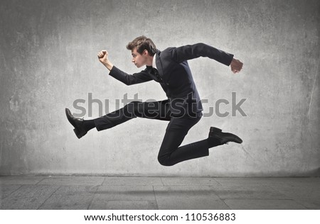 Young businessman running