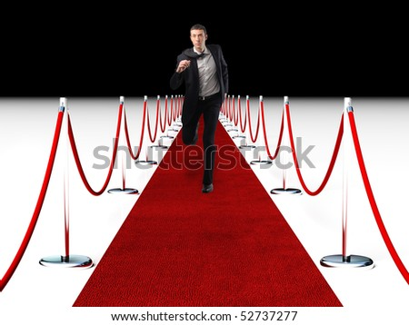 young businessman running on red carpet