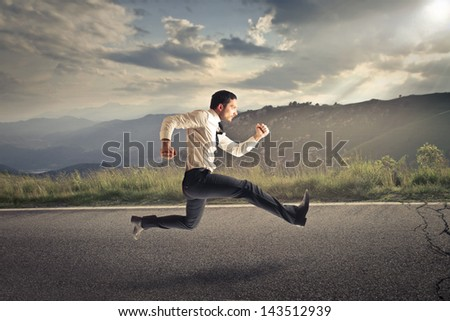 young businessman running on the road
