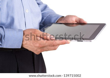 Young businessman's hands working on a tablet pc computer isolated on white