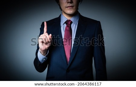 Young businessman. Serious business concept.