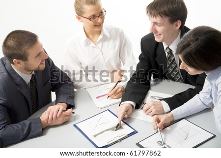 Young businessman showing chart his colleagues