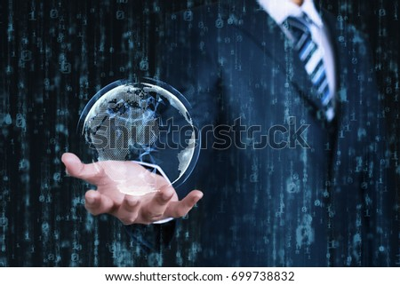 Young businessman shows a digital earth on his hand with an abstract data background. Business, Technology, Internet and network concept.  Foto d'archivio ©