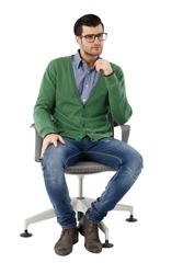 Young businessman sitting in swivel chair over white background, thinking. Full-length.