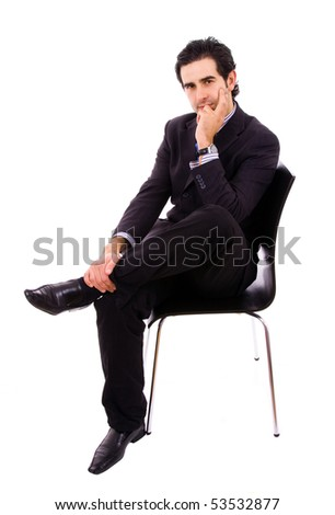 Young businessman sitting on chair, against white background