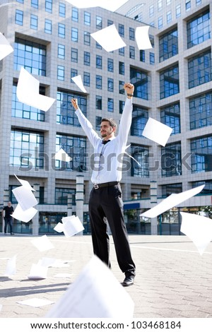 young businessman standing front his building office and throwing away his papers, Never felt so good
