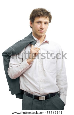Young businessman standing in confident pose with hands in pocket and his suit draped over his shoulder. Isolated on white.