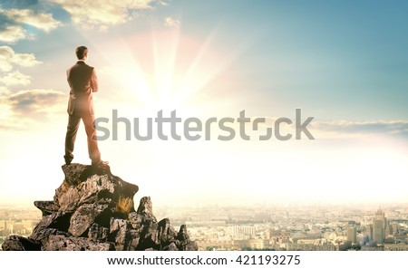 young businessman standing on...