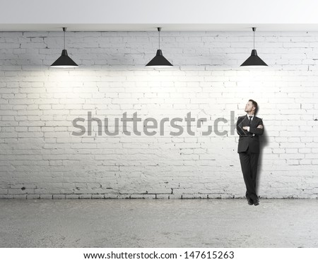 young businessman standing on loft