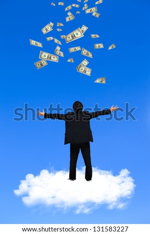 Young businessman standing on the cloud with a lot of falling dollars