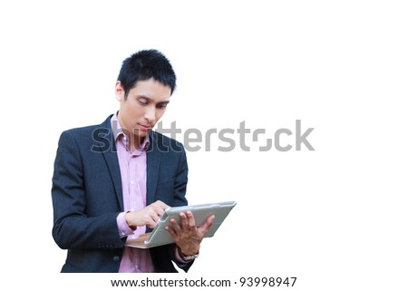 Young businessman standing with touch screen computer isolated on white