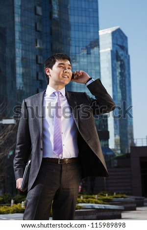 Young businessman talking on mobile phone. - stock photo