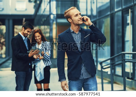 Young businessman talking on the phone. #587977541