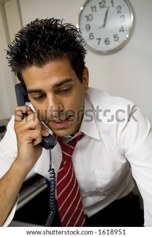 young businessman talking on the phone in his office