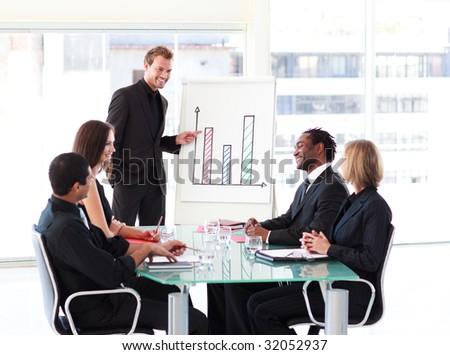 Young businessman talking to his colleagues in a presentation
