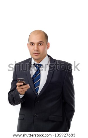 Young businessman texting - Portrait shot of a young well dressed businessman with a cell phone isolated on white background