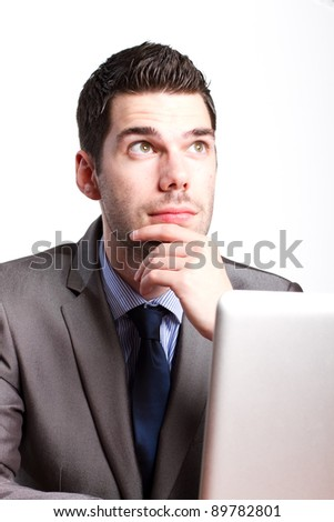 Young businessman thinking hard about a problem