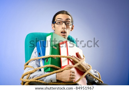 Young businessman tied with rope - stock photo