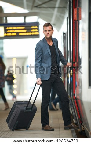 Young businessman traveling with bag at subway station