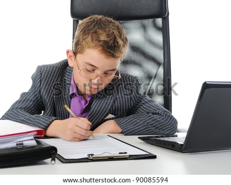 Young businessman using a laptop. Isolated on white background