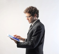 Young businessman using a tablet pc