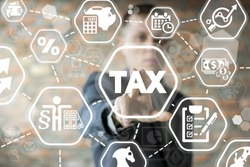 Young businessman using innovative virtual touchscreen presses tax button. Tax payment. Government, state taxes. Data analysis, paperwork, financial research, report. Calculation tax return.