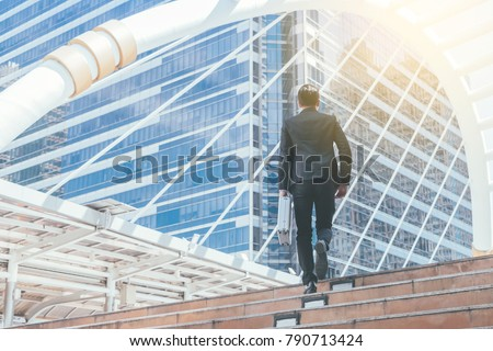 Young businessman walking in city for going to work with cityscape background. #790713424