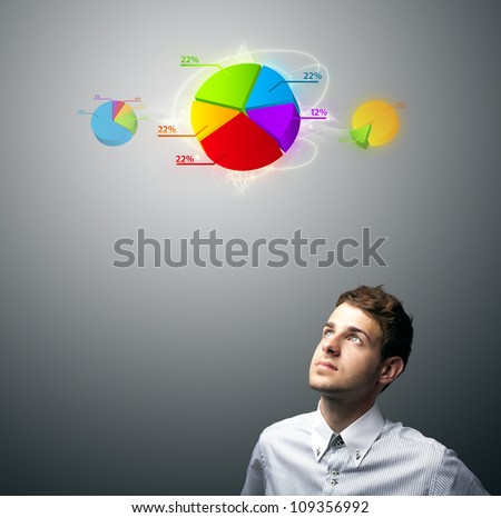 Young businessman watching virtual business sign, copyspace