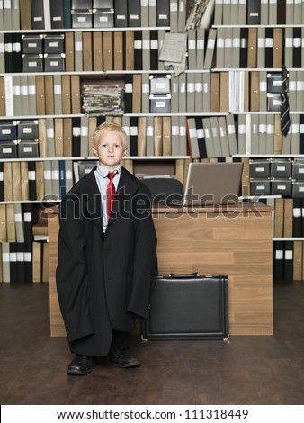 Young Businessman wearing oversized clothes in the office