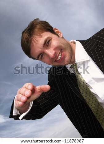 young businessman welcomes  hand on  background sky,  close up