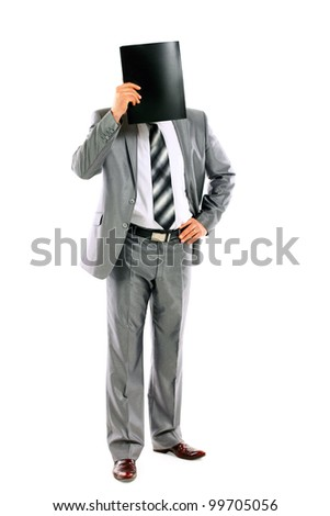 Young businessman who is afraid of anything and covering his face of the business folder isolated on white