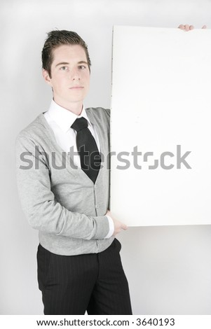young businessman with a big blank white board where you can add text - stock photo
