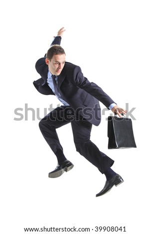 Young businessman with a briefcase jumping against white background
