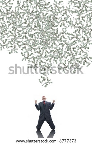 Young businessman with a lot of falling dollars