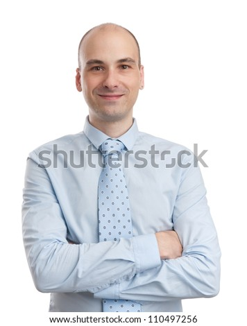 Young businessman with arms folded over white background