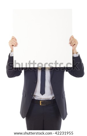 Young businessman with blank board over his face isolated on white