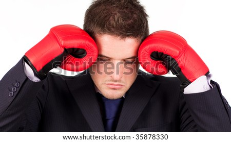 Young Businessman with boxing gloves to his head