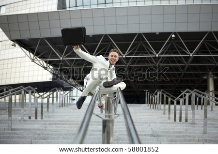 young businessman with briefcase running on stair