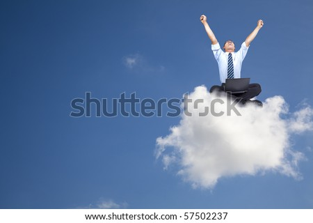 young businessman with computer sitting on the cloud - stock photo