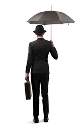 young businessman with elegant dress and umbrella