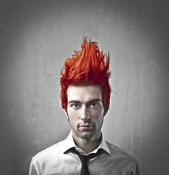Young businessman with flaming hair up in the air
