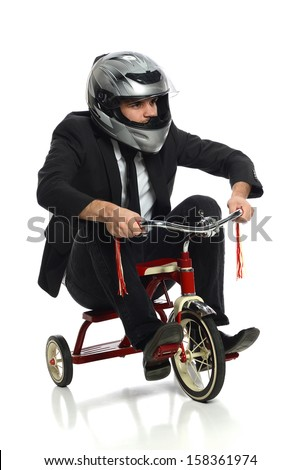 Young businessman with helmet riding tricycle isolated over white background