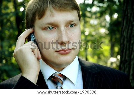 young businessman with mobile-phone. outdoor