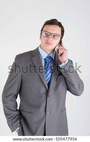 Young businessman with mobile phone wearing glasses
