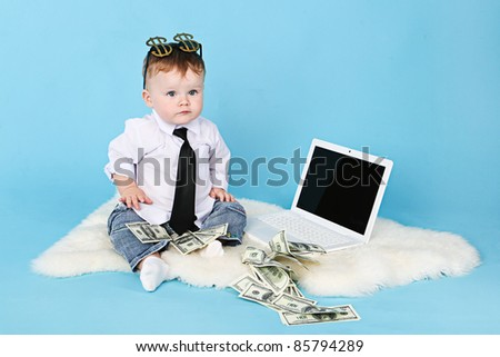 Young businessman with money and a laptop