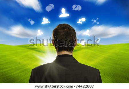 Young businessman with social network icons floating around his head 3
