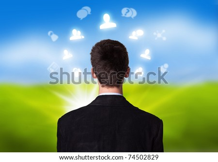 Young businessman with social network icons floating around his head 2